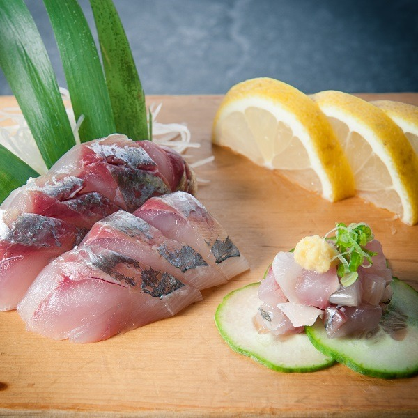 fresh cut sashimi swith lemon and cucumber at Osaka