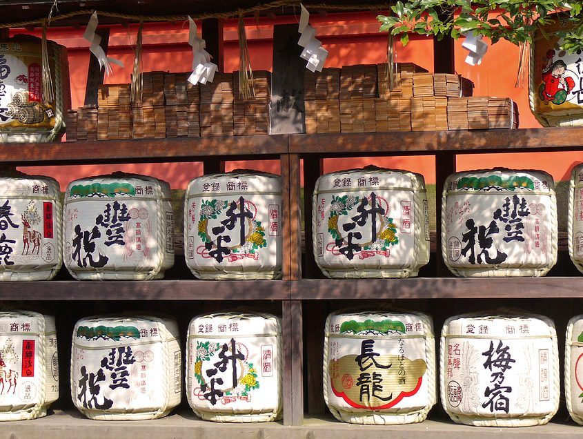 Japanese sake barrels stacked in a Shinto shrine.