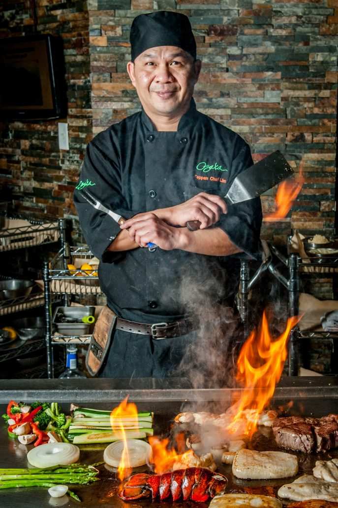 Osaka japanese restaurant teppan yaki chef over flame cooking lobster, steak and other foods