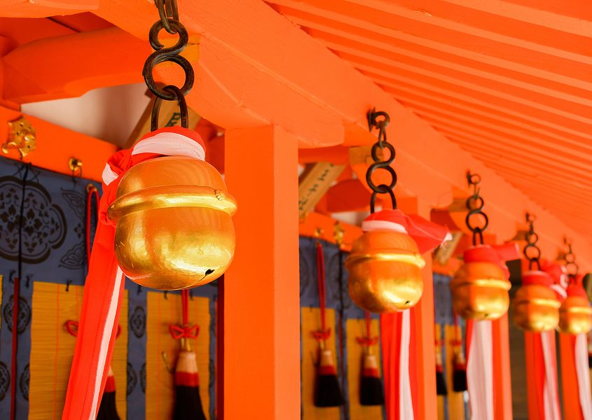 Japanese temple bells on the wall ringing for new year celebration