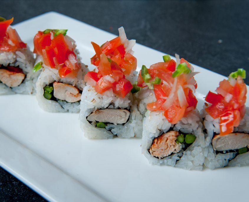 Osaka Las Vegas el pollo loco sushi roll on a plate