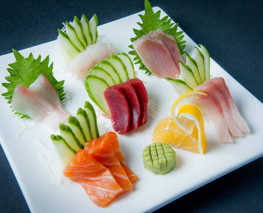 Sashimi plate fresh raw fish presented by Osaka Japanese Bistro